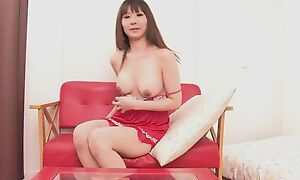 Asian bombshell fucks herself at hand double-sized dildo